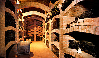 Underground wine cellar full of bottles